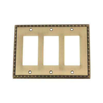 Egg and Dart Switch Plate with Triple Rocker in Antique Brass