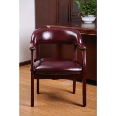 Captains Chair. Burgundy Vinyl. Mahogany Finish. Brass Nail Heads