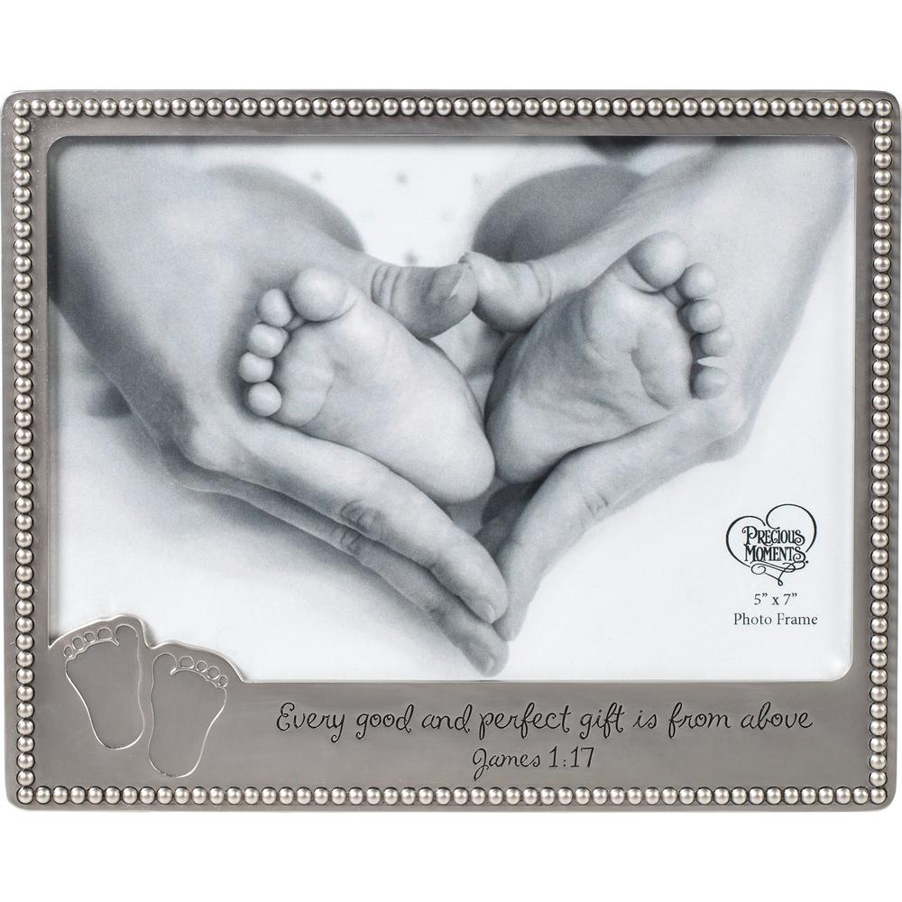 Precious Moments 5 in. x 7 in. Baby Footprints Silver Zinc Alloy Picture Frame Adorned with a beautiful religious message adorable footprint and a sweetly elegant bead edging this photo frame will be proudly displayed by proud parents for years to come. New parents will be inspired by this decorative photo frame each and every time they see the inspirational message about their precious little blessing. Looks lovely in baby shower or new baby gift baskets. Silver tone finish makes it easy to place in any nursery decor scheme, Mix and match with our baby trinket tray and box 172451 and 172452.H HHJj Bring this lovely gift to a baby shower a new baby welcome or for a baby's first birthday party, Silver tone makes it easy to place in just about any baby room decor scheme. Carefully crafted with Zinc Alloy. 6 in. H x 7.5 in. W Holds 5 in. x 7 in. photo.