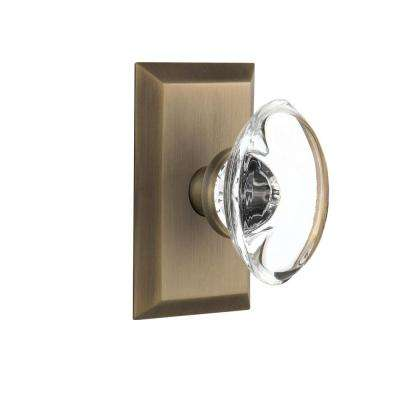 Studio Plate 2-3/8 in. Backset Antique Brass Privacy Oval Clear Crystal Glass Door Knob