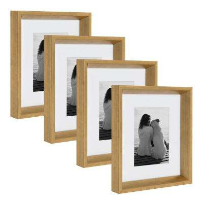 Calter 8 in. x 10 in. Matted to 5 in. x 7 in. Gold Picture Frame (Set of 4)