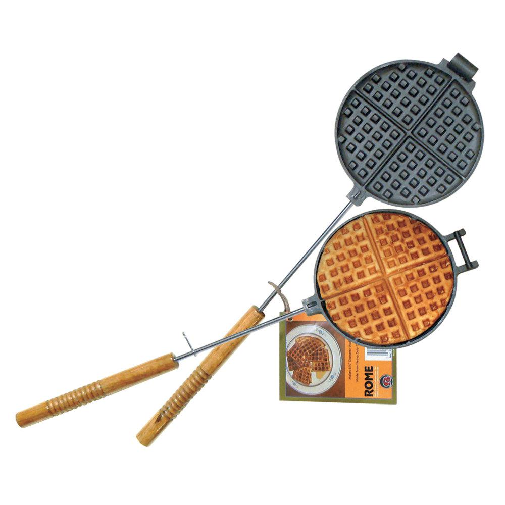 Chuck Wagon Waffle Iron Before electric cooking devices were common, cast iron waffle irons were the standard and used on stoves, open fires and woodstoves. This design is the same diameter as our #1100, but the Pie Iron style removable handles make it perfect for BBQ grill use. Original design by Rome.