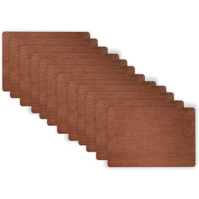 19 in. x 13 in. Copper Metallic Stitched PVC Placemats (Set of 12)