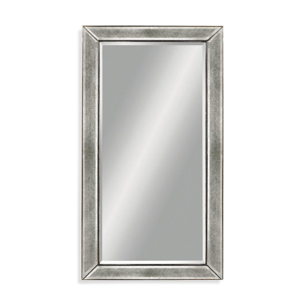 BASSETT MIRROR COMPANY Beaded Decorative Wall Mirror This alurring Beaded Wall Mirror features a traditional rectangular shape. The shining silver leaf finish, adding the essence of regality to any living space. Can be used in many different settings.
