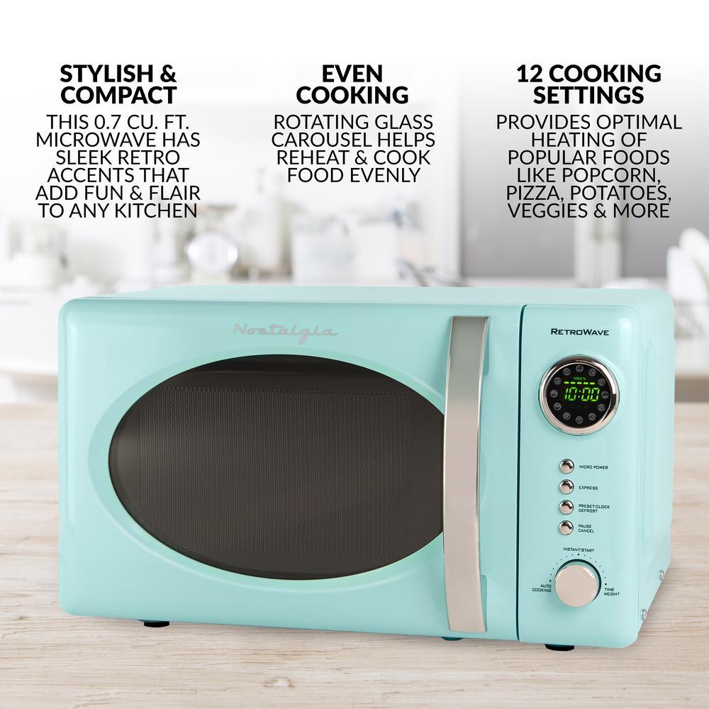 Nostalgia Retro Series 0 7 Cu Ft Countertop Microwave Oven In Aqua Rmo7aq The Home Depot