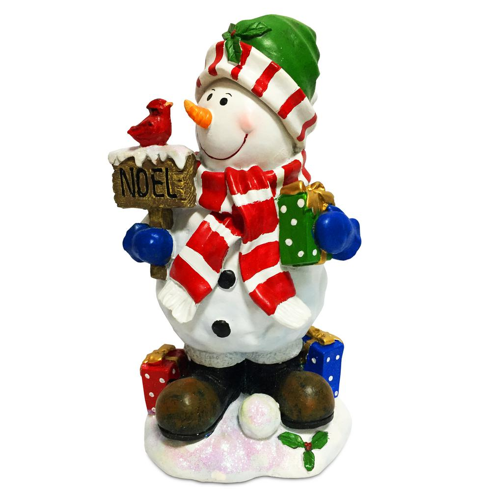 National Tree Company 13 in. Snowman with Sign, Gifts and Cardinal This smiling snowman in scarf, cap and boots, is holding a wrapped gift in one hand with other gifts at his feet. In the other hand is a sign reading NOEL with a red cardinal sitting on top. It is constructed of molded composite material and hand painted in bright colors. This unique decorative piece will provide many years of enjoyment and can be displayed in indoor or covered outdoor locations.