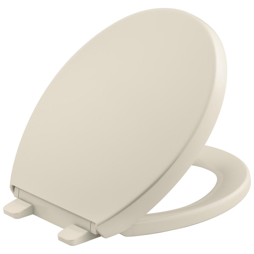 KOHLER Grip Tight Reveal Q3 Round Closed Front Toilet Seat in Almond