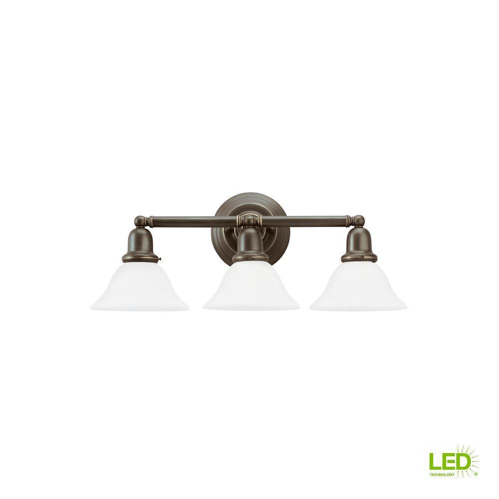 Sea Gull Lighting Sussex 3-Light Heirloom Bronze Bath Light with LED Bulbs