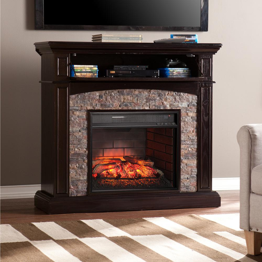 Provide a convenient update for your decor by using Southern Enterprises Newburgh Faux Stone Corner Infrared Electric Media Fireplace in Ebony.