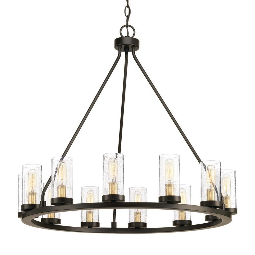 Rustic chandeliers lighting the home depot hartwell collection 12 light antique bronze chandelier with clear seeded glass and natural brass accents arubaitofo Images