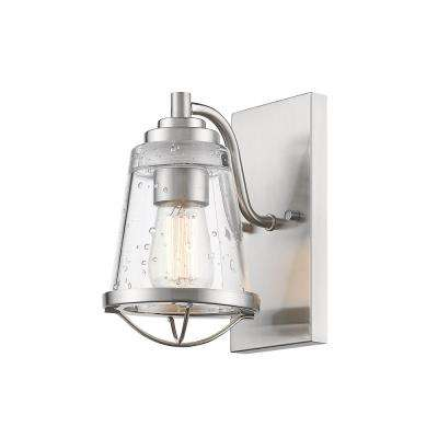 Lorinda 1 Light Brushed Nickel Wall Sconce With Clear Seedy Glass Shade