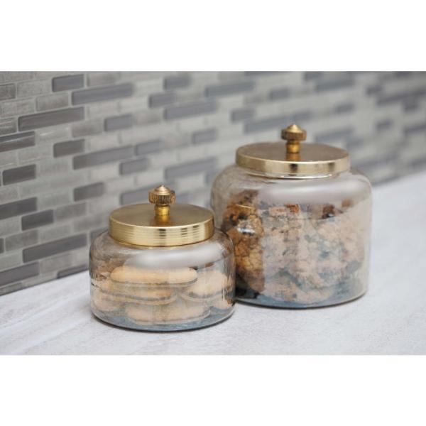 CosmoLiving by Cosmopolitan Cylindrical Smoked Gold Glass Jar with Gold Iron