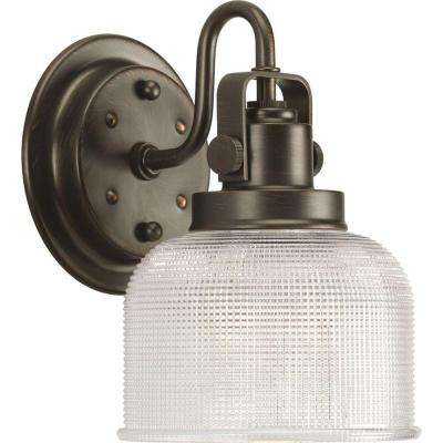 Archie Collection 1-Light Venetian Bronze Bath Sconce with Clear Prismatic Glass Shade
