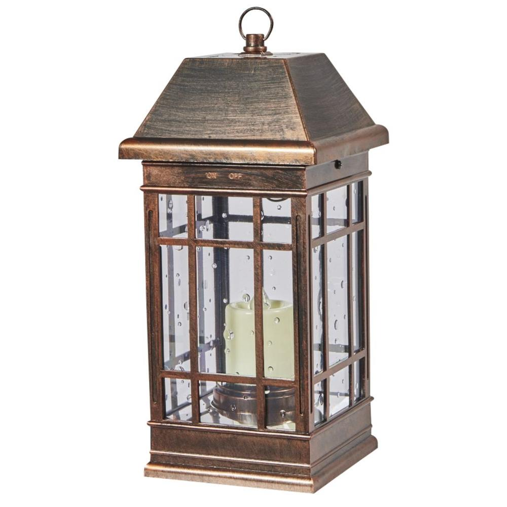 Battery outdoor lamps outdoor lighting the home depot san rafael ii mission solar pillar candle lantern in antique bronze aloadofball Gallery
