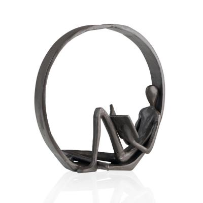 Encircled Reader Cast Iron Sculpture