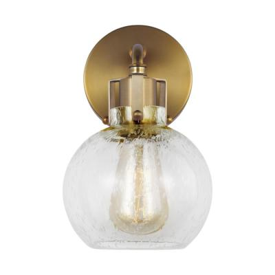 Clara 6.25 in. Burnished Brass Sconce with Clear Seeded Glass Shade