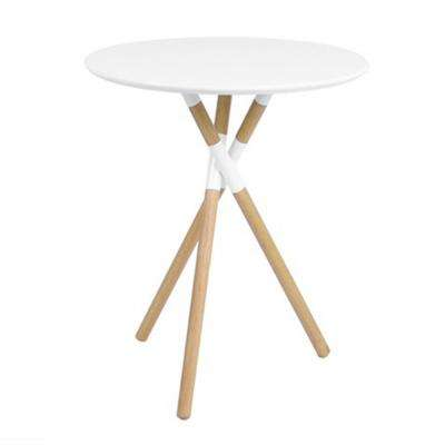 Round White Table With Natural Wood Legs
