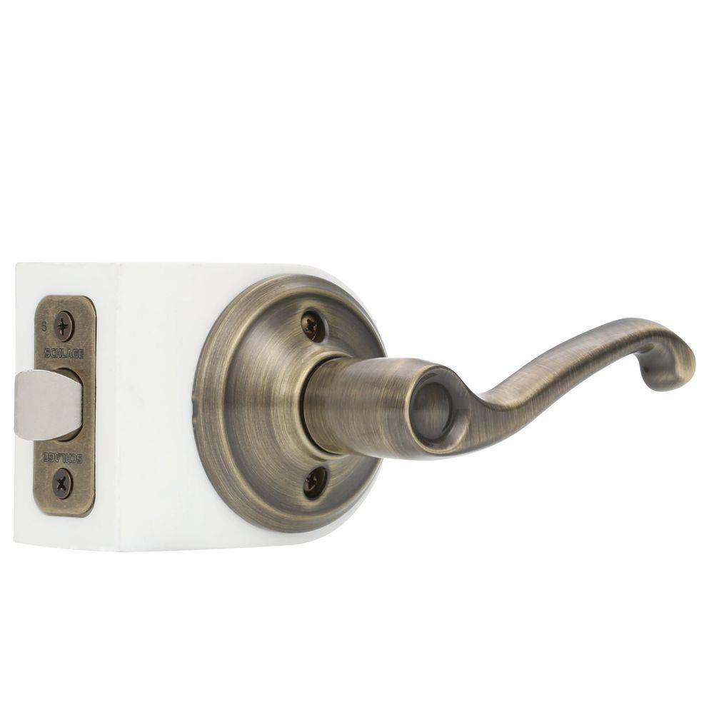 Schlage Flair Antique Brass Passage Hall/Closet Door Lever