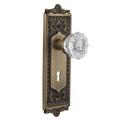 Egg and Dart Plate with Keyhole 2-3/4 in. Backset Antique Brass Privacy Crystal Glass Door Knob