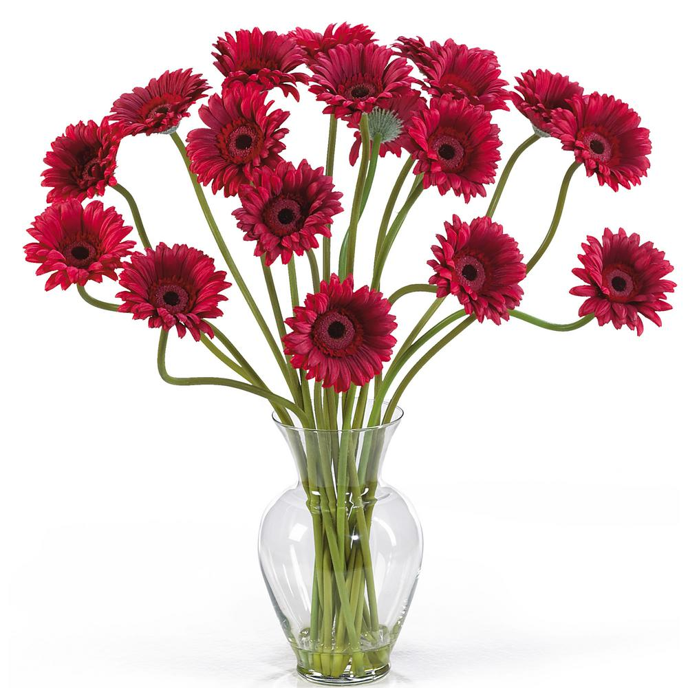 Nearly Natural 21 in. Gerber Daisy Liquid Illusion Silk Flower Arrangement in Red Take a look at this Gerber Daisy silk arrangement. Fun, excitement, and color only begin to describe its beauty. Standing 21 in. tall this exciting piece features eighteen stems of Gerber Daisy's set in a classic glass vase with artificial water. If you're looking to brighten up your home or office decor, well. You've just found a winner. Available in five gorgeous shades: beauty, orange, pink, red, yellow and mixed.