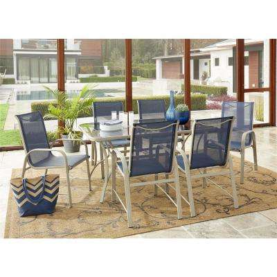 Paloma 7-Piece Tempered Glass Table Top Outdoor Dining Set with Sand Frame and Navy Sling Chair