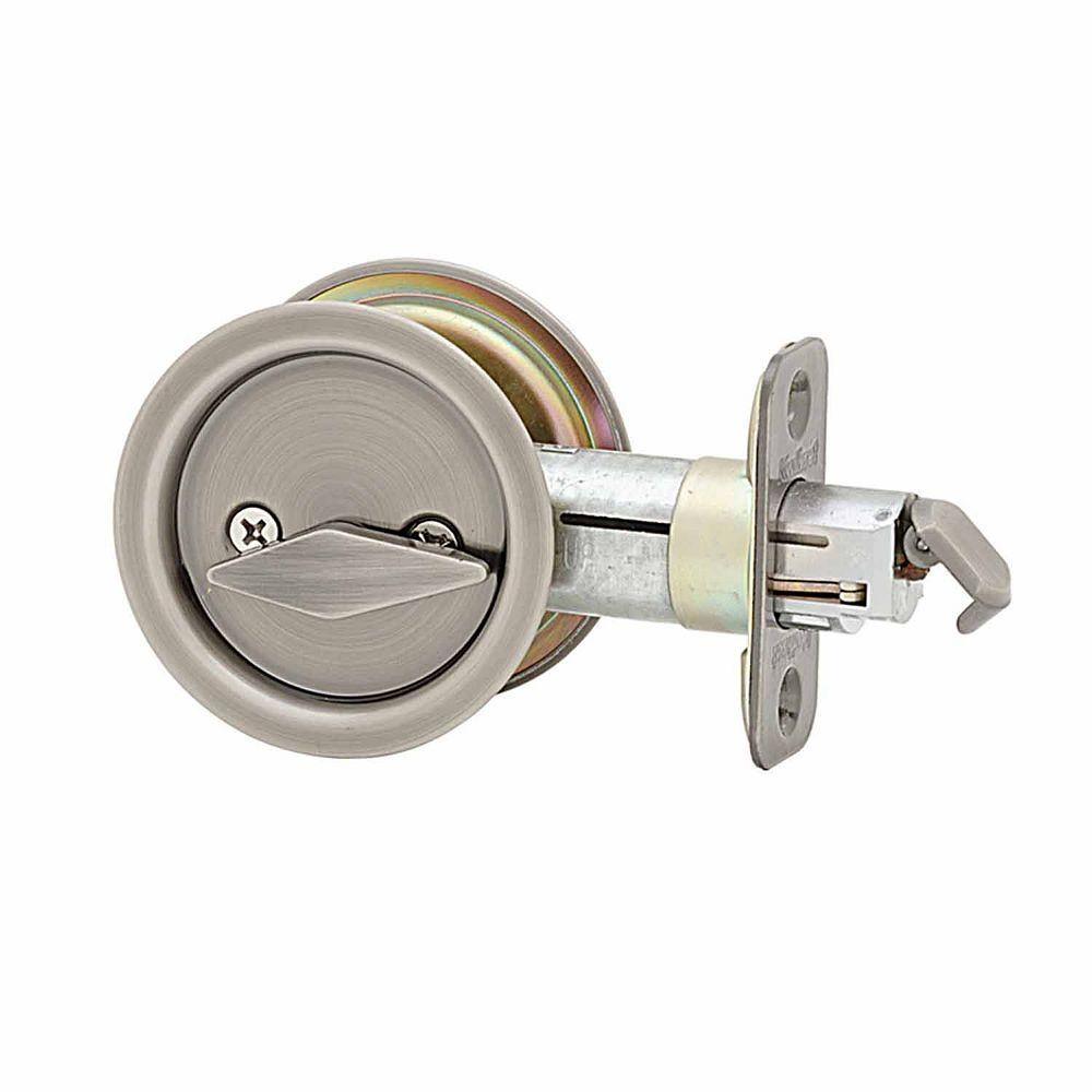 Kwikset Round Antique Nickel Bed Bath Pocket Door Lock 335 15a Rnd Pckt Dr Lck The Home Depot