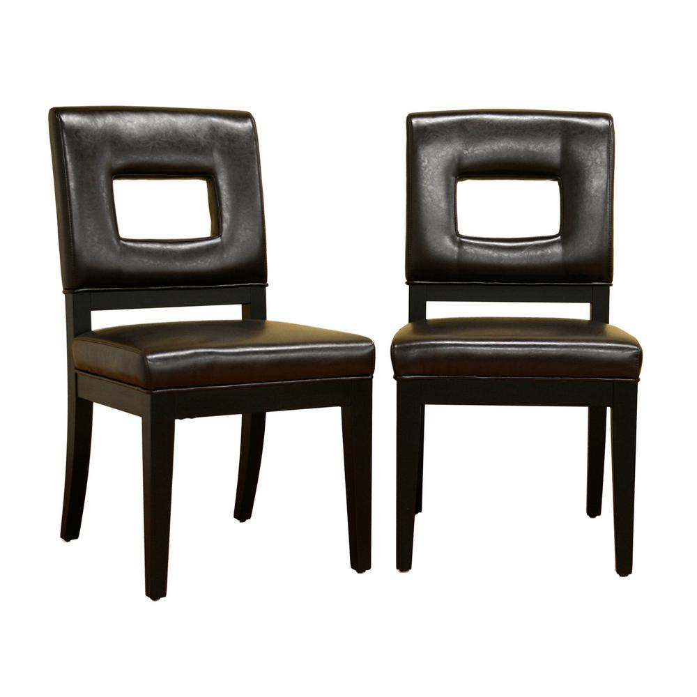 Baxton studio faustino dark brown faux leather upholstered for Faux leather dining chairs