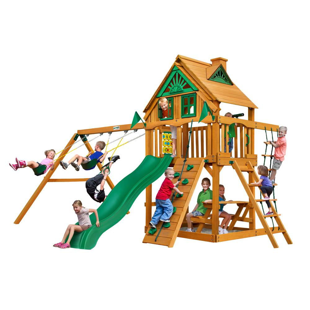 Gorilla Playsets Chateau Treehouse Wooden Swing Set with Rock Wall and Picnic Table