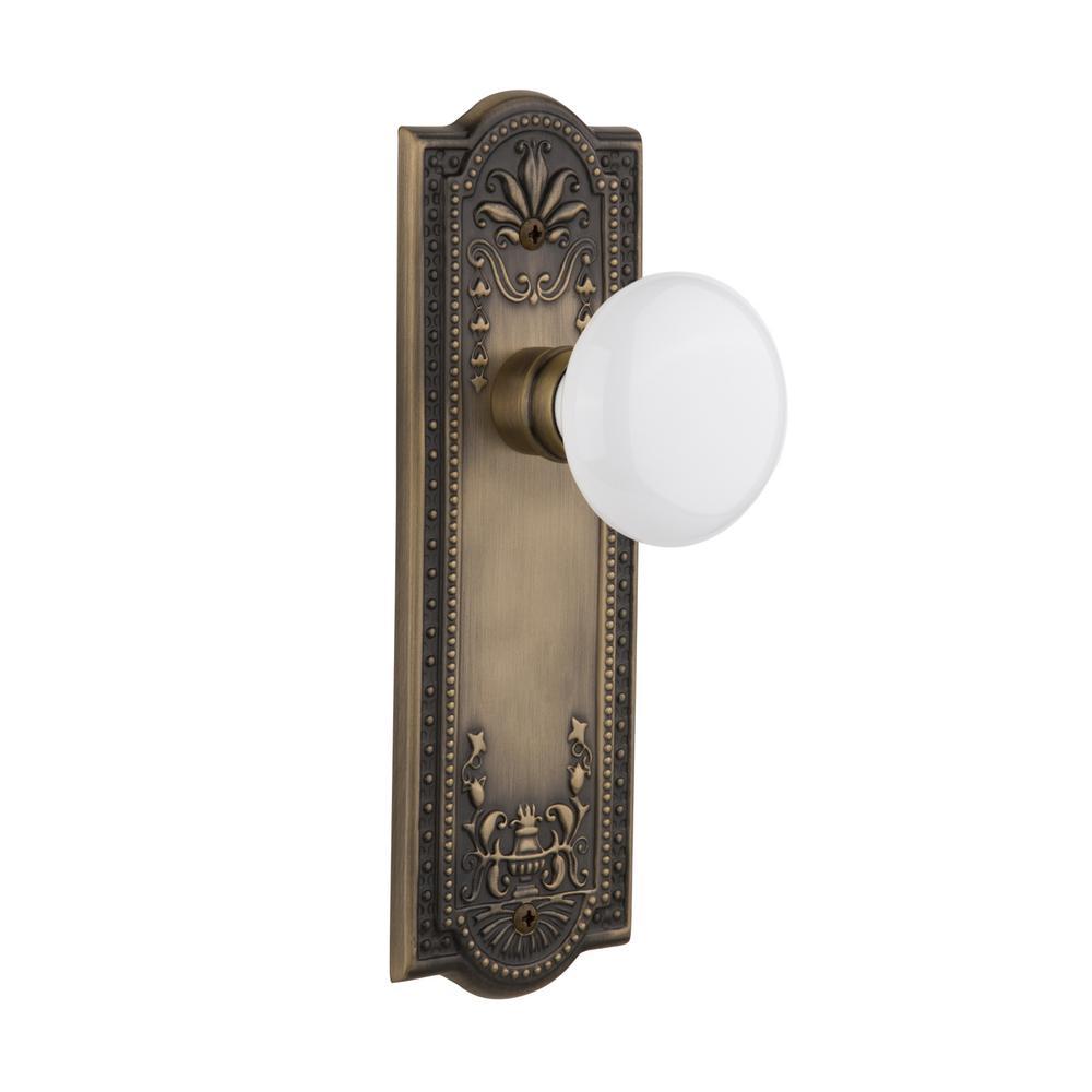 Meadows Plate Single Dummy White Porcelain Door Knob in Antique Brass