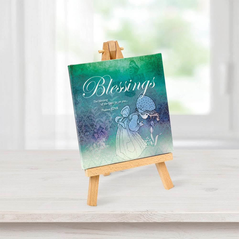 Precious Moments Tabletop Multi-Color Canvas Home Decor Blessings Picture with Easel, Multi An encouraging psalm is beautifully illustrated on a canvas in hues of greens and blues to soothe the soul, included easel allows for easy display anywhere. A truly memorable gift, it brings the spirit of Psalm 129:8 into any living or work space with beautiful patterns and traditional Precious Moments imagery. Give as a religious gift, housewarming gift, inspirational gift or motivational gift for holidays, birthdays or 'just because'. Printed on canvas with wooden easel display. Canvas approximately 8 in. H x 5 in. W. Color: Multi.