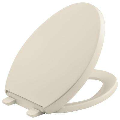 Reveal Quiet-Close Elongated Closed Front Toilet Seat with Grip-tight Bumpers in Almond