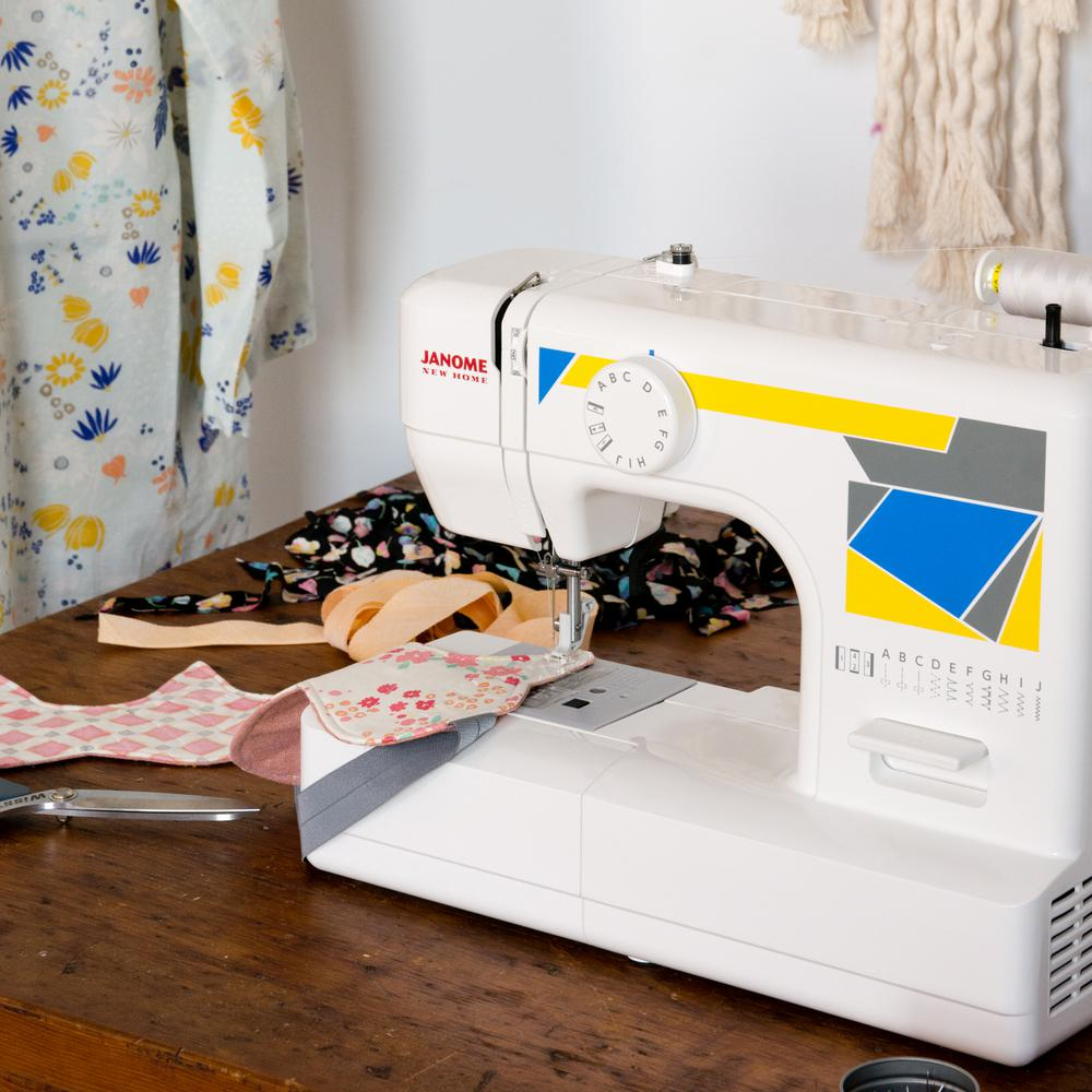 Janome MOD-11 Basic Sewing Machine with Top Drop-In Bobbi...
