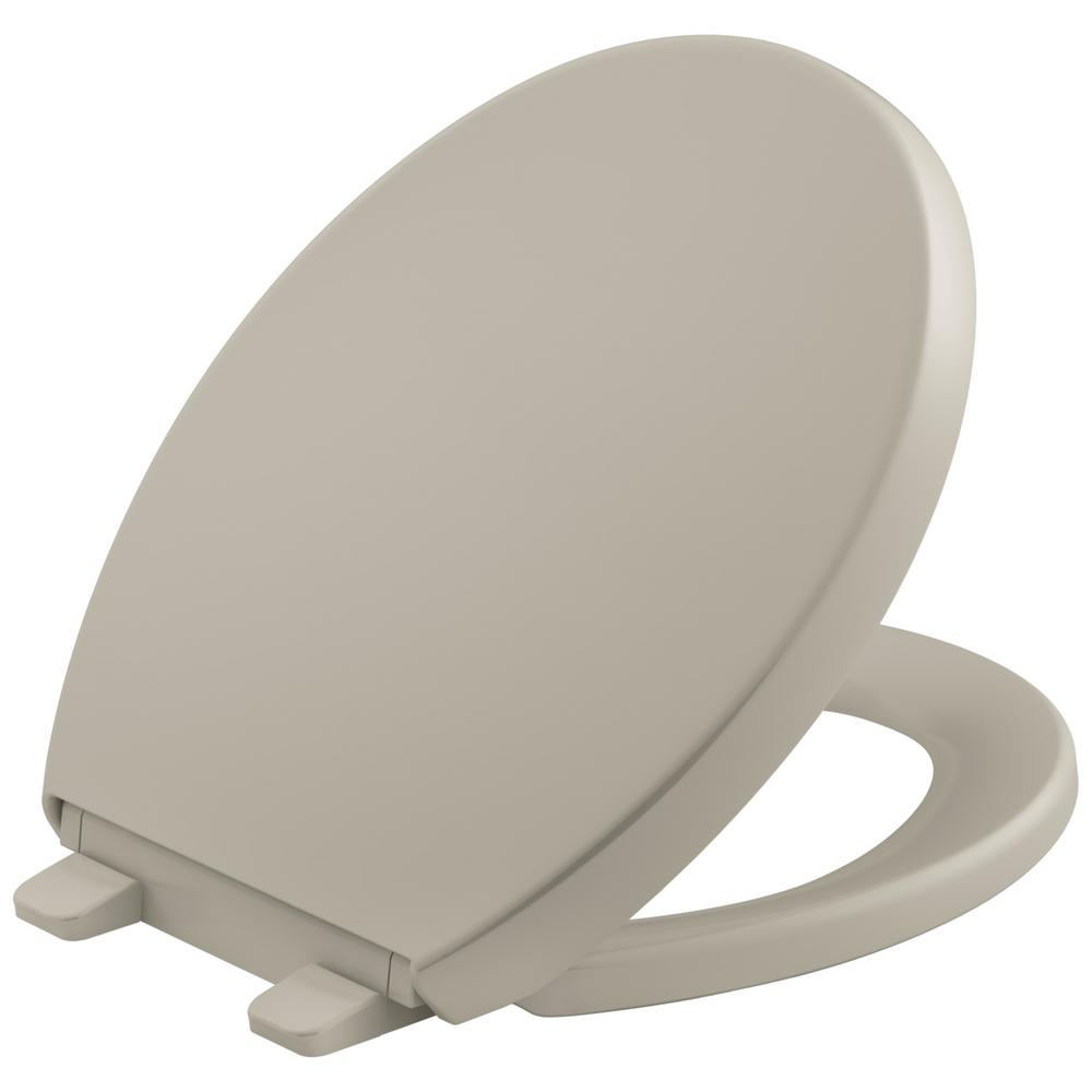 KOHLER Reveal Quiet-Close Round Closed Front Toilet Seat with Grip-tight Bumpers in Sandbar