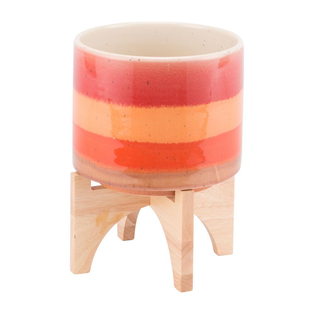 7.9 in. W x 10.4 in. H Orange Ceramic Planter