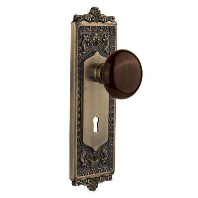 Egg and Dart Plate with Keyhole Double Dummy Brown Porcelain Door Knob in Antique Brass
