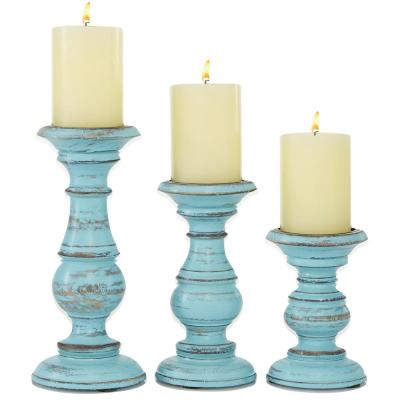 """Light Blue Wood Pillar Candle Holder with Brown Accents, Set of 3: 10.1""""H, 7.95""""H, 6.05""""H"""
