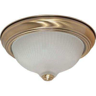 Elektra 2-Light Antique Brass Flushmount with Frosted Swirl Glass