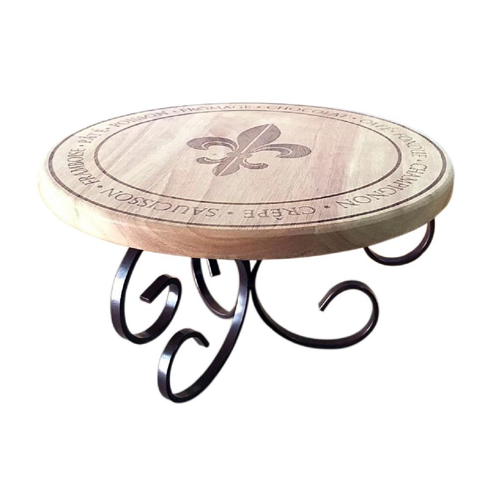Epicureanist Fleur de Lis Wood Stand Featuring an elegant design, Epicureanists Fleur de Lis Pedestal Stand brings a regal look to any setting. Sturdy iron scrolls swirl to support a wood tray with engraved fleur de lis design. A must-have addition for the dining table, this stand gives your favorite dish, drinks, or appetizers some height, creating a memorable presentation that is sure to impress.