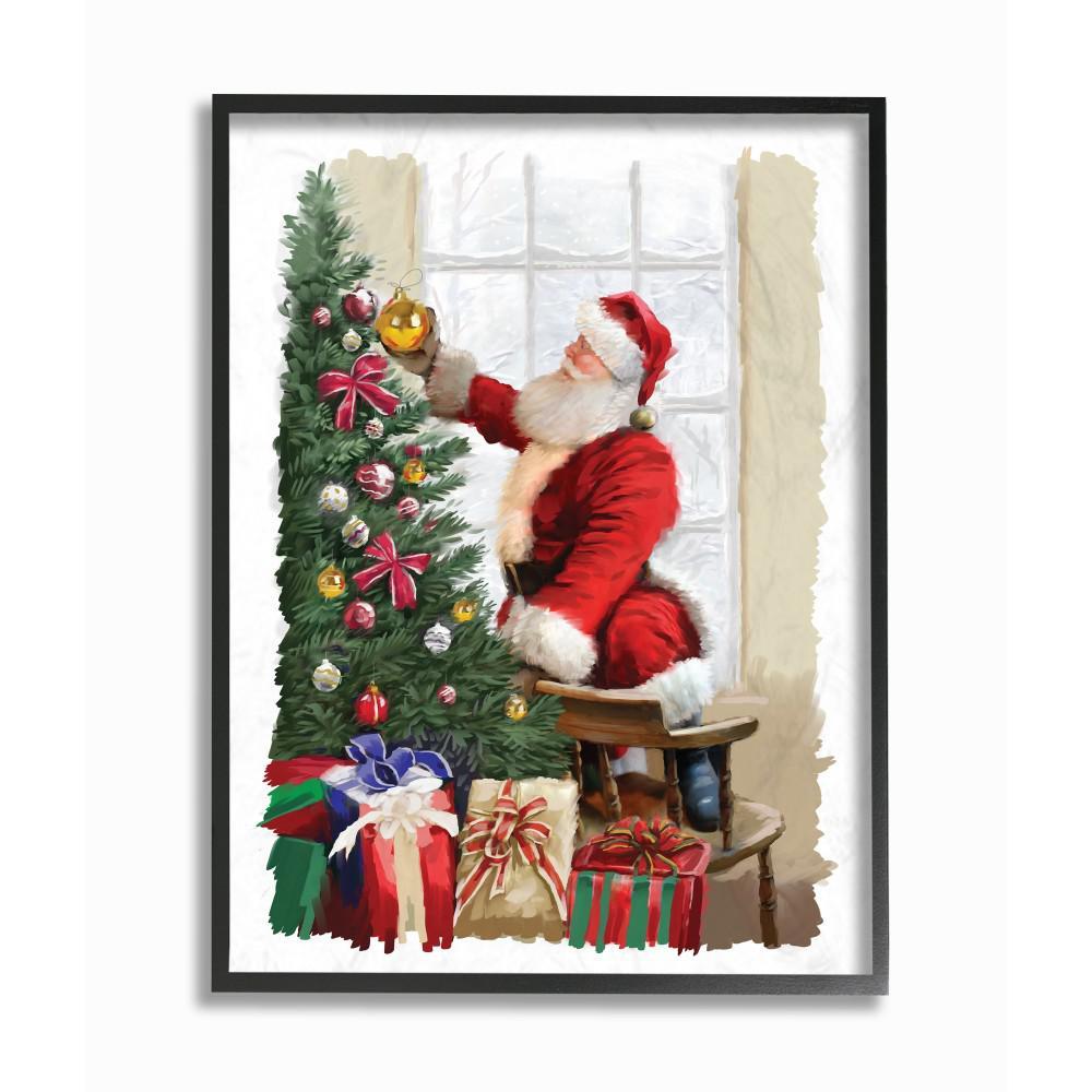 holiday santa decorating christmas tree with