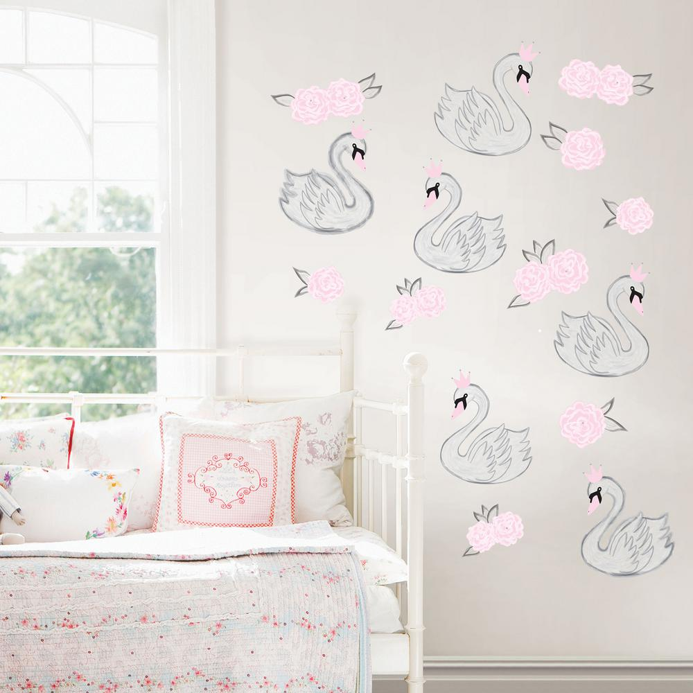 Wall Pops Pink Swan Song Wall Decal Graceful white swans wear charming light pink crowns in this fanciful wall art kit. With darling pink roses, this dreamy wall kit is fit for a princess. Swan Song Wall Art Kit contains 15-pieces on 4-sheets that measure 17.25 in. x 9.75 in.