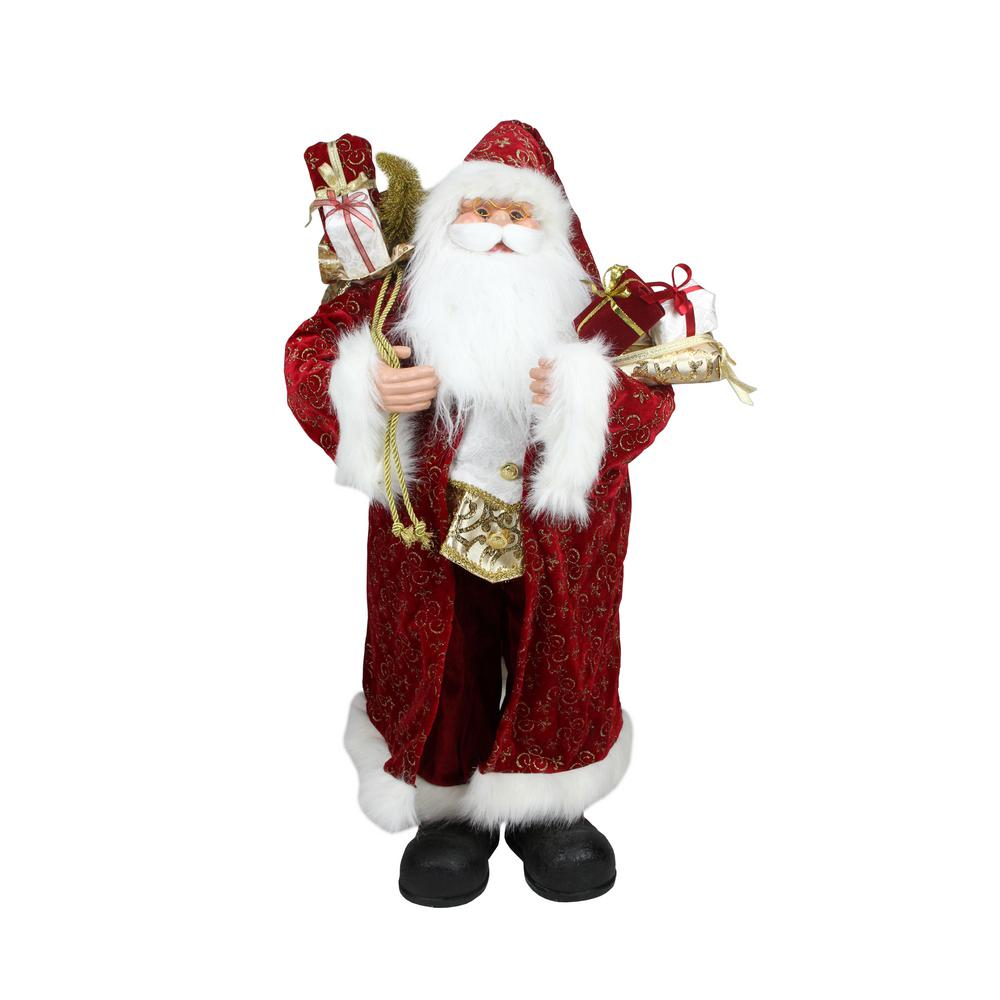 Northlight 32 in. Christmas Standing Santa Claus in Long Red and Gold Robe with Gifts Figure This Santa Claus is full of classic Christmas charm and would make a jolly addition to your holiday decor. Santa is wearing a red coat with gold glittered fleur-de-lis scroll accents over his red and white suit. A bag of presents is over Santa's shoulder while he is carrying more gifts in his other hand. Santa features jolly blue eyes round chubby cheeks and friendly smile. Santa's hat features a jingle bell at the end. Recommended for indoor use. Dimensions: 32 in. H x 16 in. W x 14 in. D Material(s): plastic/fabric.