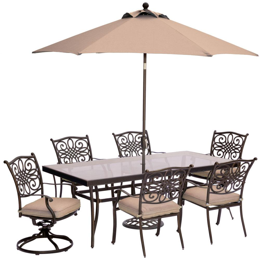 Hanover 7-Piece Outdoor Dining Set with Rectangular Glass Table, 2 Swivels, Umbrella and Base with Natural Oat Cushions