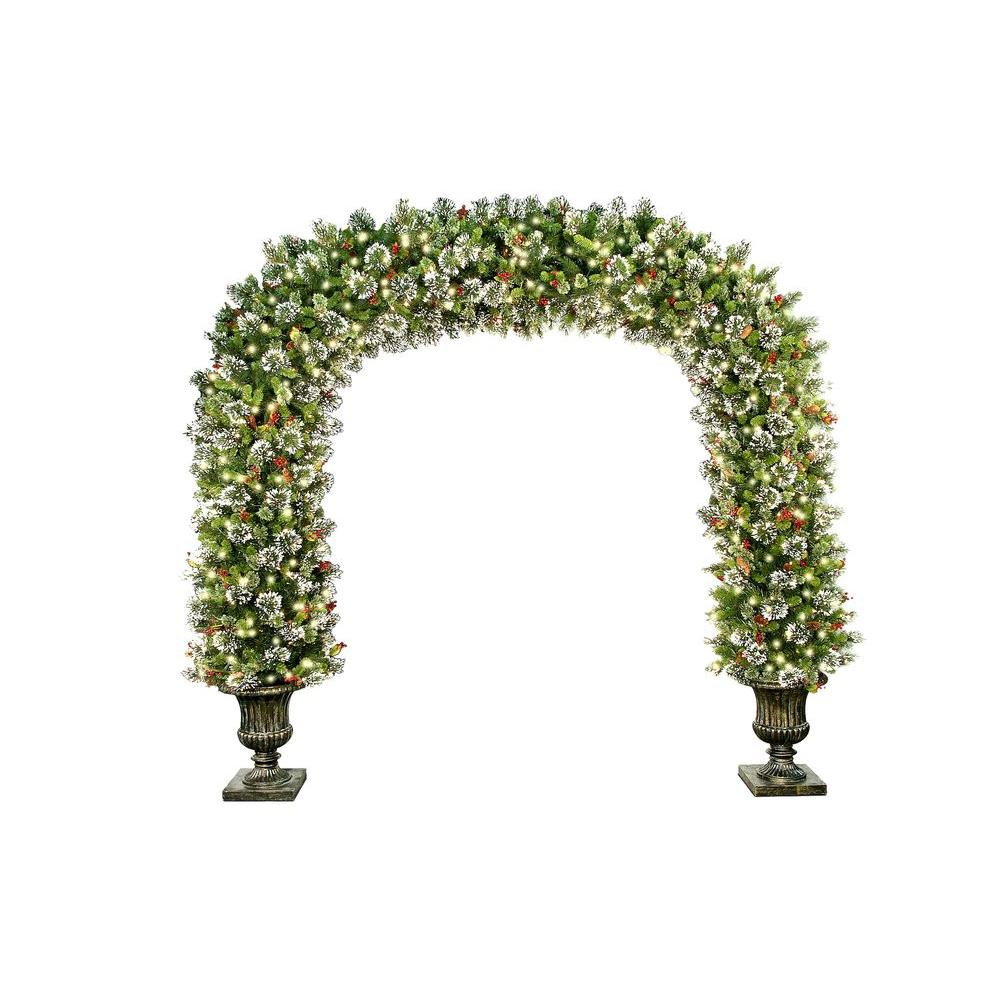 National Tree Company 8.5 ft. Wintry Pine Archway with Cones, Red Berries and Snowflakes in Dark Bronze Fiberglass Pot with 900 Clear Lights