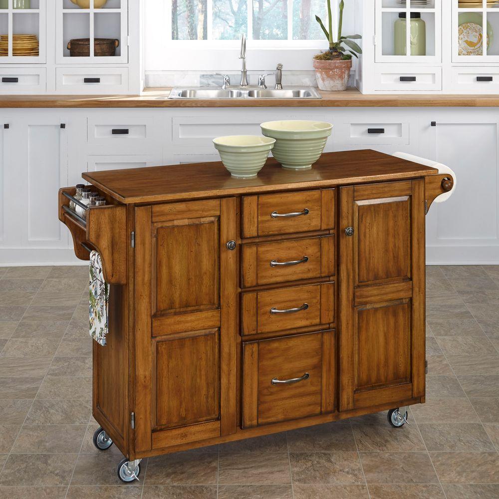 Home styles create a cart warm oak kitchen cart with towel bar